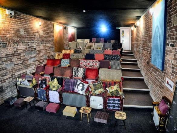 Inside the small boutique Northern Light Cinema, bright comfortable sofas and cushions